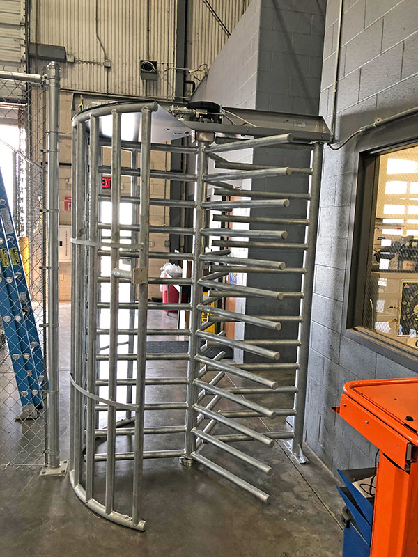 Alvarado full height turnstile with access control into warehouse